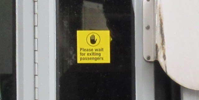 """Please wait for exiting passengers"" - Yarra Trams sticker"