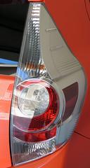 wheel(0.0), rim(0.0), grille(0.0), automobile(1.0), automotive tail & brake light(1.0), automotive exterior(1.0), vehicle(1.0), automotive lighting(1.0), automotive design(1.0), bumper(1.0),