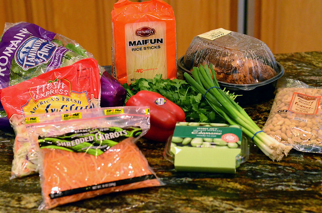 All the ingredients required to make the Thai Chicken Salad arranged on a counter top.