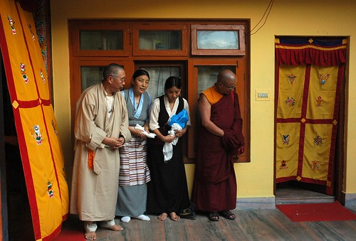 Four Tibetans reverently waiting for His Holiness Dagchen Sakya, upstairs near the dining hall & kitchen, Tibetan door covers swing in the breeze, Sakya Lamdre, Tharlam Monastery of Tibetan Buddhism, Boudha, Kathmandu, Nepal by Wonderlane