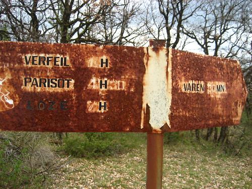 Old walking sign in the middle of the forest