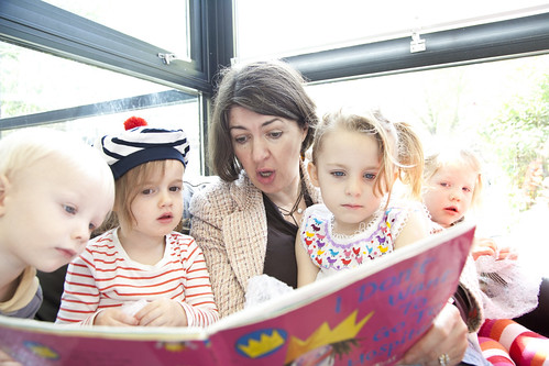 June O'Sullivan takes time out to read to children at LEYF's Noah's Ark Community Nursery in Tower Hamlets