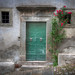 <p>The streets in Cortona all seem to be going uphill!  I loved the splash of colour this rosebush added to the scene.</p>
