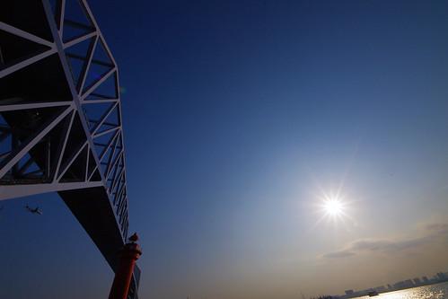 sun reflecting Tokyo Gate Bridge