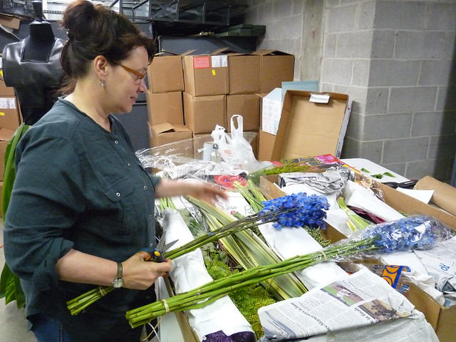 Dextras selects materials for the pieces she is creating for the Spring Gala and featured at After Party. Photo by April Greene.