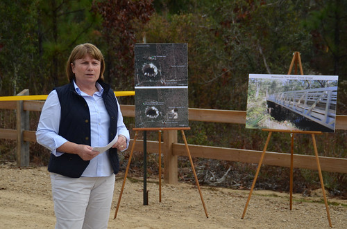 Alex Weiss, Florida Department of Environmental Protection, discussed the benefits of the recently completed Springhill Motorcycle Trailhead on the Apalachicola National Forest to a crowd gathered for its grand opening. The new facility is a short distance from Tallahassee, Fla. (U.S. Forest Service Photo/Susan Blake)