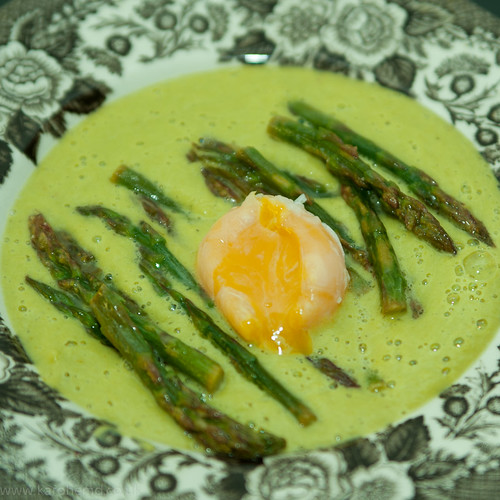 Cream of asparagus soup, poached duck's egg yolk