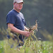 Small photo of Farmer Scouting & Inspecting Weeds