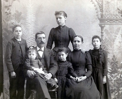 Paul, Zelpha, Pa Briggs, Ivy (standing), Grace, Ma, and Harriet (Cabinet Card by unidentified photographer)