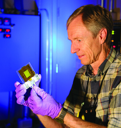 Los Alamos scientist Meiring Nortier holds a thorium foil test target for the proof-of-concept production experiments. Research indicates that it will be possible to match current annual, worldwide production of Ac-225 in just two to five days of operations using the accelerator at Los Alamos and analogous facilities at Brookhaven.