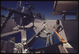 Prototype of a linear parabolic reflector used to gather the sun's energy and heat fluid in the center pipe to several hundred degrees F..., 04/1974