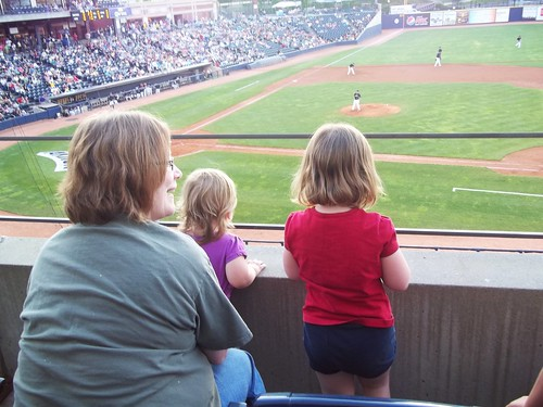 Grandma, Phoebe and Lucy watch the Aeros game