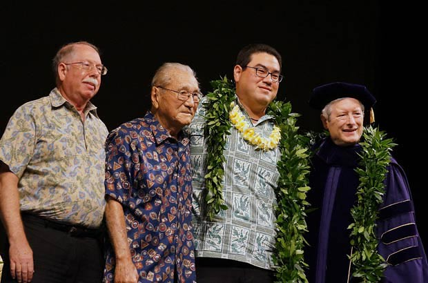 <p>Aaron Karlen with his dad and grandfather and School of Medicine Dean Jerris Hedges at the school's convocation ceremony on May 13 (Aaron and his sister Naomi are the first brother and sister to graduate in the same JABSOM class)</p>