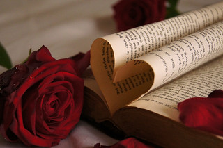 Book pages folded into a heart shape and roses