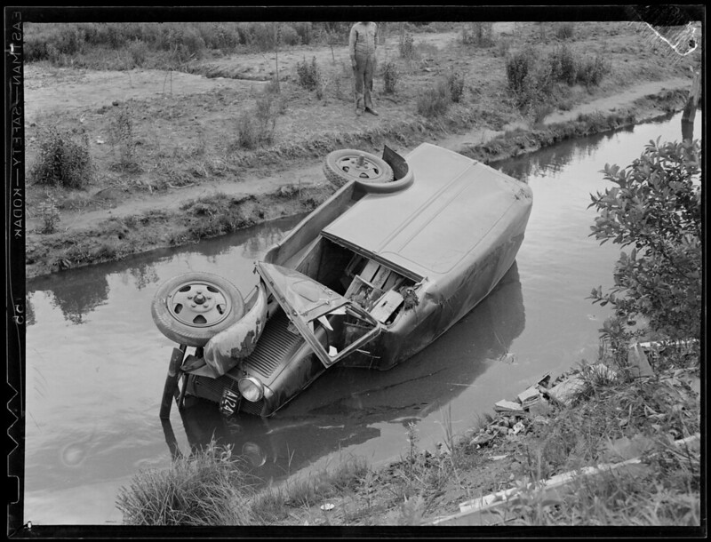 Truck goes into watery ditch