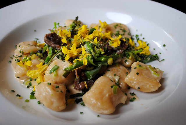 Beef cheek proscuitto, house made dumplings, spring onion, rabe, and fresh kale flowers at Spints Alehouse in NE Portland