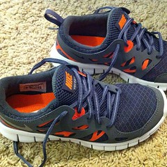 orange(1.0), cross training shoe(1.0), outdoor shoe(1.0), running shoe(1.0), sneakers(1.0), footwear(1.0), nike free(1.0), shoe(1.0), athletic shoe(1.0),