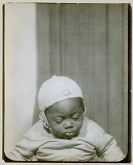Photobooth baby in cap