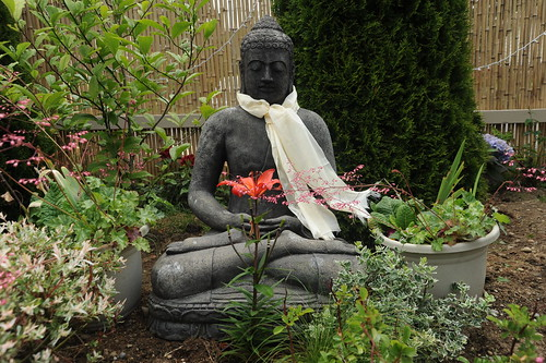 A Garden for the Buddha, khata on blessed concrete Buddha statue, newly planted, Seattle, Washington, USA by Wonderlane