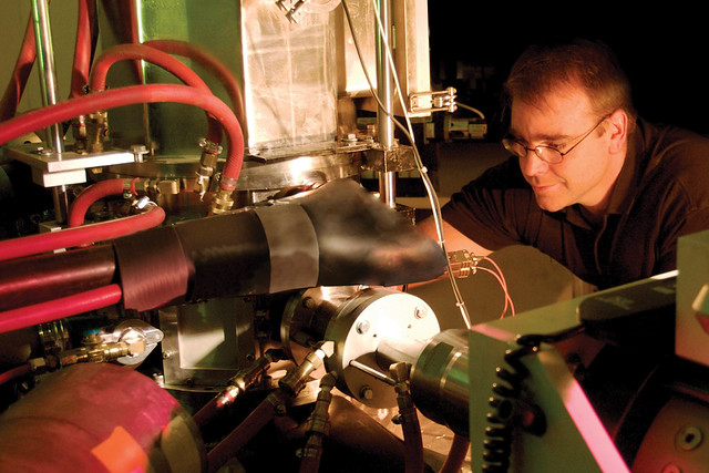 Don Brown, instrument scientist for the Spectrometer for Materials Research at Temperature and Stress, makes final adjustments before the beam is available to the Lujan Neutron Scattering Center.
