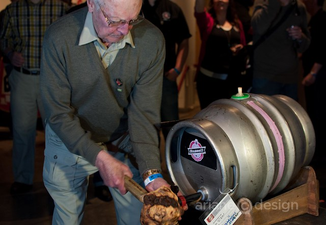 John Mitchell, BC's first craft brewer, taps the Collaboration Ale keg