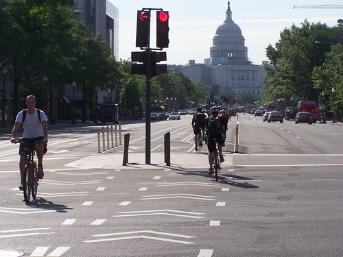 Bicyclists in the cycletrack on Pennsyvlania Avenue NW, Washington, DC, with the US Capitol in the foreground