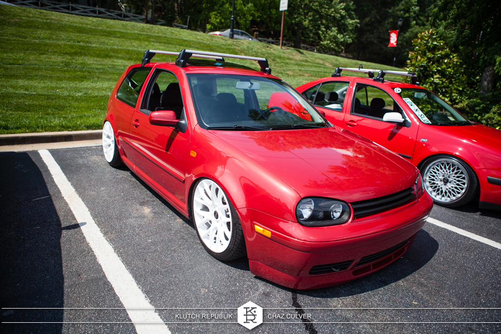 matchstick red mk4 vw gti lowered on airride with white miro 111 wheels at southern worthersee 2012