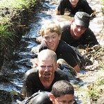 June 15, 2011 - 22:59 - Dallas County Iowa Sheriff Chad Leonard in the mud with the cadets from the Character Building Academy.  Cadets participate in a two week leadership program that is designed to challenge and educate young men and woman on subjects such as self respect, being a good citizen, volunteering in your community and interviewing techniques for gaining future employment.  Students are required to complete five challenges during the two weeks with the last challenge being a 6 mile mud run.Credit: Shannon Rollings, Dallas County Sheriff's Office