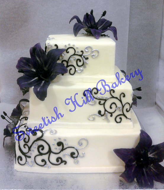 Purple and black wedding cake serves 100 by sweetishhillbakery