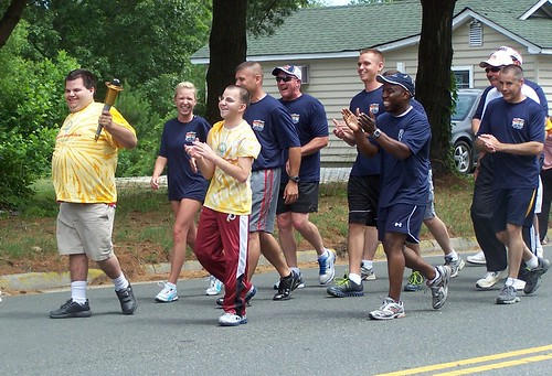 Special Olympics athletes took turns carrying the torch through Kilmarnock
