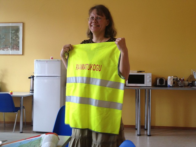 Ewa Roots showing a safetyvest Tartu library has made for some cycling event