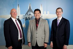From left to right, New Mexico Spaceport Authority Board Chairman Rick Holdridge, Las Cruces Mayor Ken Miyagashima and Virgin Galactic CEO George Whitesides at the Virgin Galactic Las Cruces office opening. Photo by Jesse Ramirez