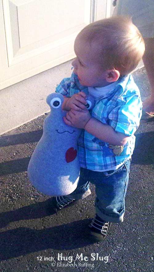Hug Me Slug with Toddler, handmade art toy by Elizabeth Ruffing