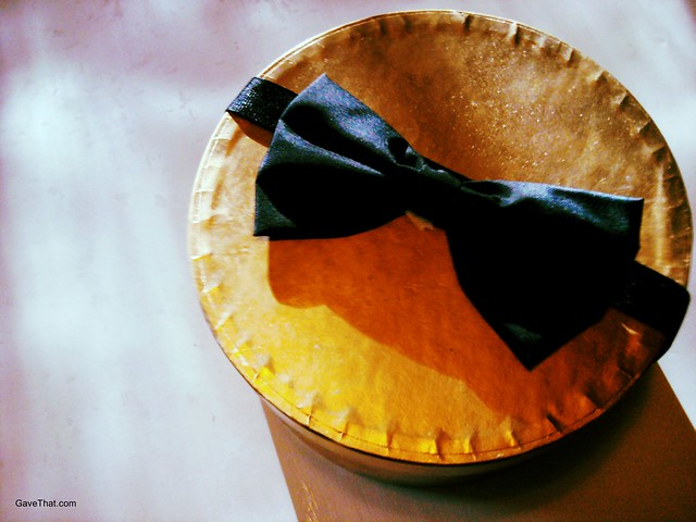 Gift bow on hat box using Grosgrain ribbon and a vintage bow tie which can later be turned into a prim belt