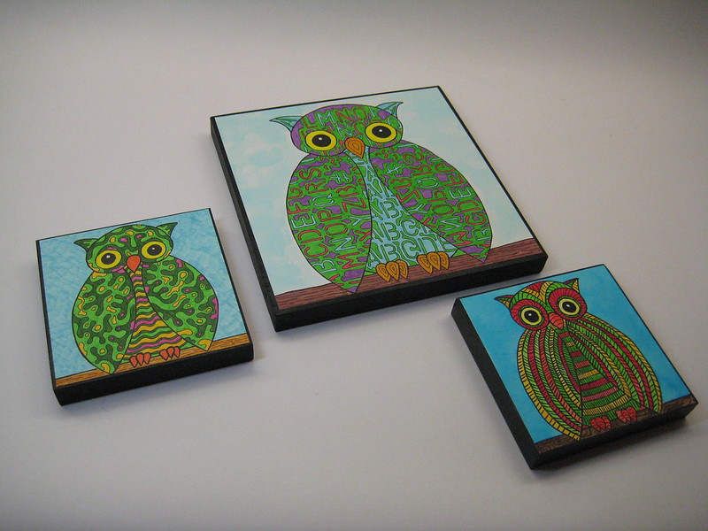 owls on wood blocks