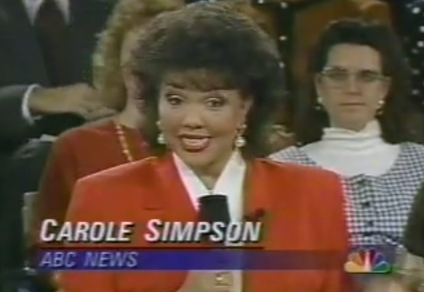 Carole Simpson talks into the camera at the debate