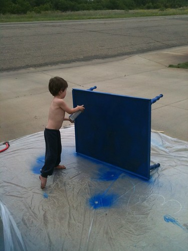 N helps spray paint the Lego table