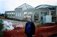 Roma Waite in front of the construction of the library building which now bears her name.