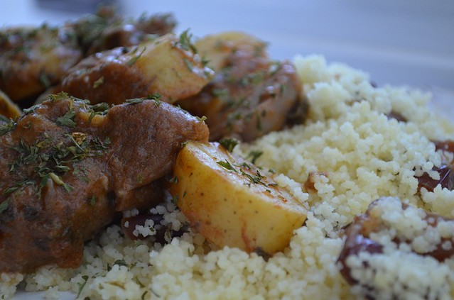 goat stew over couscous with dates