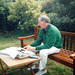 my dad in Ireland writing in the garden