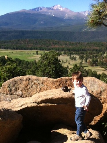 Chase and Buddy stop for a look at Longs Peak in Rocky Mountain National Park.