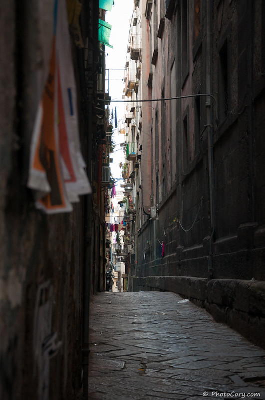 very dark narrow street in Naples Italy