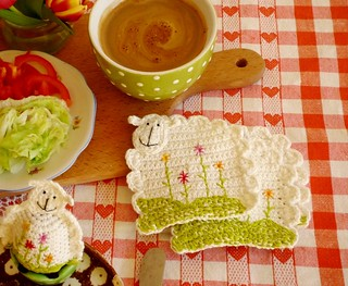 crochet sheep coasters with flowers