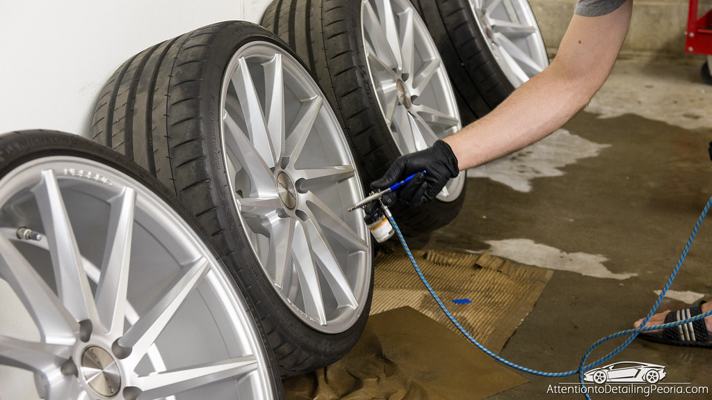 wheels being sprayed with CarPro DLUX