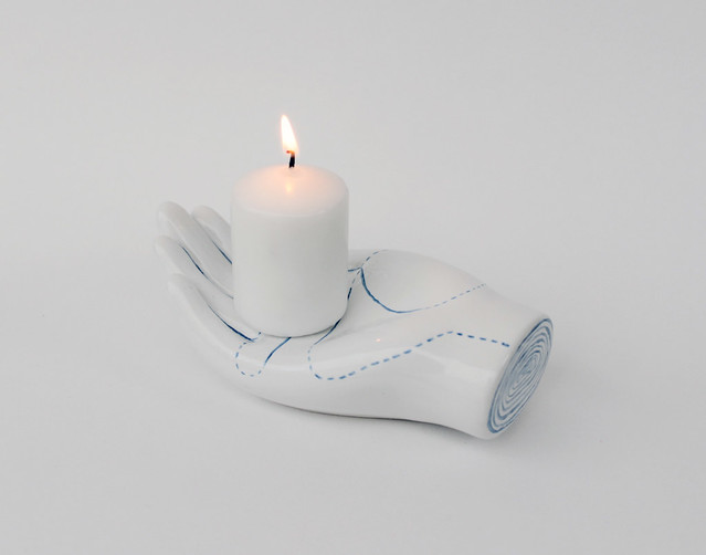 hand with candle