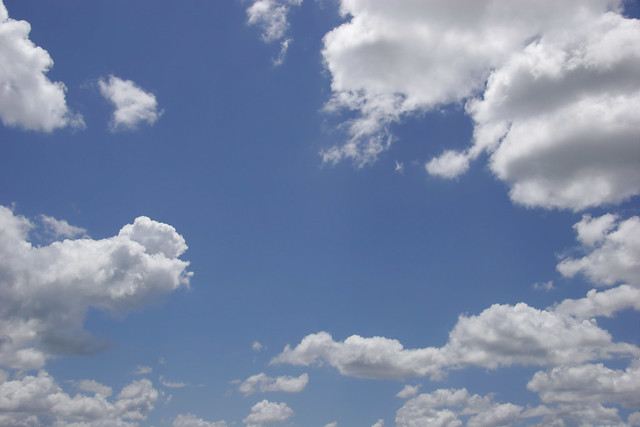 Puffy White Clouds, Blue Sky