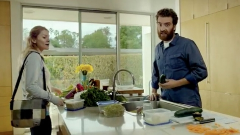 screen shot from the Sunrun ad campaign. A white man and woman are in their kitchen together