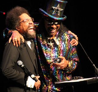 Bootsy Collins giving an award to Cornel West