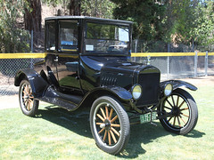 ford model a(0.0), touring car(0.0), automobile(1.0), ford model a(1.0), vehicle(1.0), ford model tt(1.0), antique car(1.0), classic car(1.0), vintage car(1.0), land vehicle(1.0), luxury vehicle(1.0), ford model t(1.0),