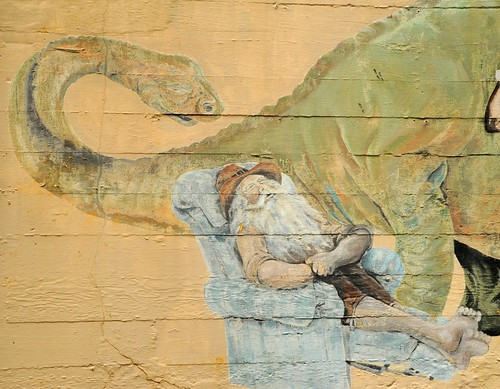 Rip Van Winkle sleeping in a Lazyboy, and dinosaur, alley art, mural, Aberdeen, Grays Harbor, Washington, USA by Wonderlane